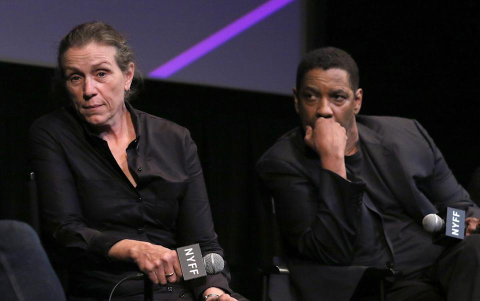 """Frances McDormand, left, and Denzel Washington attend a press conference for """"The Tragedy of Macbeth,"""" the opening night film of the New York Film Festival."""