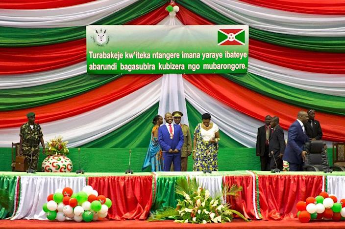 Burundi's President Pierre Nkurunziza (C) smiles after being sworn in for a controversial third term in power, at the Congress Palace in Kigobe district, Bujumbura on August 20, 2015 (AFP Photo/Griff Tapper)