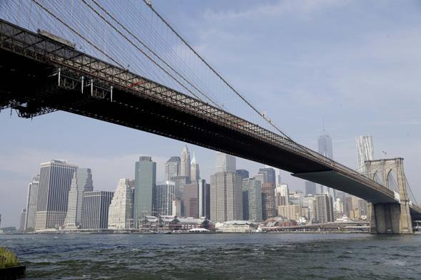 The Brooklyn Bridge stretches in front of the Manhattan skyline in New York, Thursday, Sept. 12, 2013. (AP Photo/Seth Wenig)