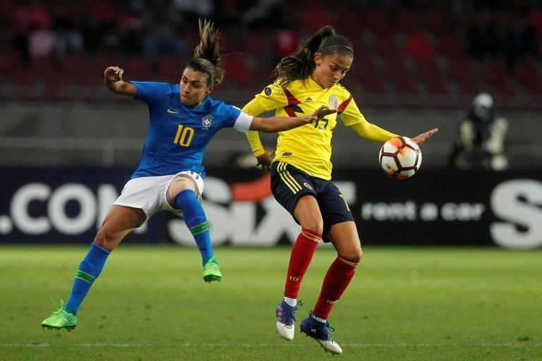 Brazil's player Marta (L) fights for the ball with Colombia's player Isabella Echeverri