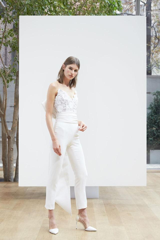 <p>Model wears a lace bodice and white pant look from the Spring 2018 Bridal collection. (Photo: Courtesy of Oscar de la Renta) </p>