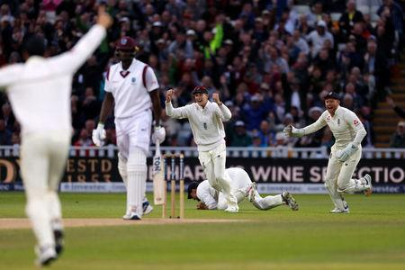 Cricket - England vs West Indies - First Test - Birmingham, Britain - August 19, 2017 England's Alastair Cook catches out West Indies' Jason Holder as England's Joe Root and Jonny Bairstow celebrate Action Images via Reuters/Paul Childs