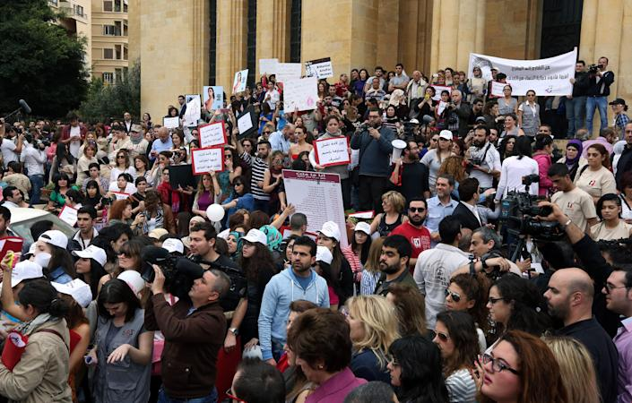 Lebanese citizens rally making International Woman's Day demanding that parliament approves a law that protects women from domestic violence in Beirut, Lebanon, Saturday, March 8, 2014. Several cases of domestic violence slayings in Lebanon in recent months, has drawn new attention to women's rights in this country of 4 million people. Although Lebanon appears very progressive on women rights compared to other countries in the Middle East, domestic violence remains an unspoken problem and the nation's parliament has yet to vote on a bill protecting women's rights nearly three years after it was approved by the Cabinet. (AP Photo/Bilal Hussein)