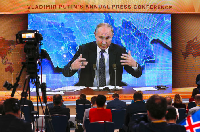 Russian President Vladimir Putin gestures as he speaks via video call during a news conference in Moscow, Russia, Thursday, Dec. 17, 2020. This year, Putin attended his annual news conference online due to the coronavirus pandemic. (AP Photo/Alexander Zemlianichenko)