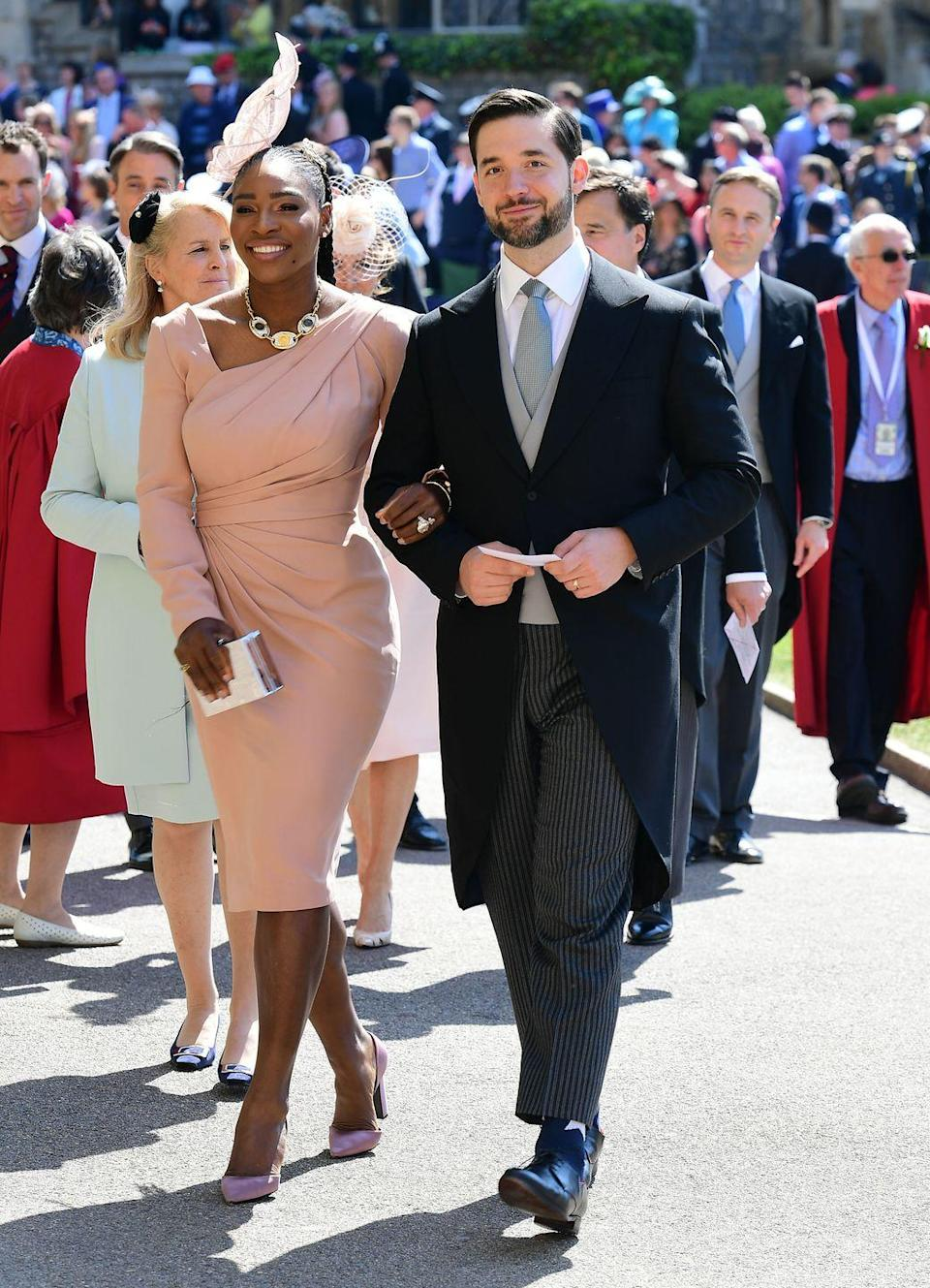 <p>Serena Williams knocked it out the park in her stunning pink structured dress, alongside husband Alexis Ohanian, as they arrived at Meghan and Harry's big day at Windsor Castle. </p>