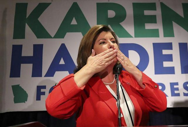 Karen Handel blows a kiss with her husband, Steve, looking on while thanking supporters during her election night party in the Sixth District race with Jon Ossoff on Tuesday, June 20, 2017, in Atlanta. (Curtis Compton/Atlanta Journal-Constitution via AP)