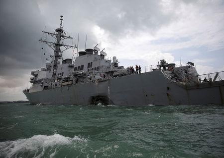 The U.S. Navy guided-missile destroyer USS John S. McCain is seen after a collision, in Singapore waters August 21, 2017. REUTERS/Ahmad Masood