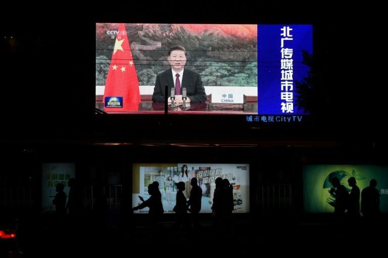 An image of Chinese President Xi Jinping appearing by video link at the United Nations General Assembly is seen on an outdoor screen in Beijing