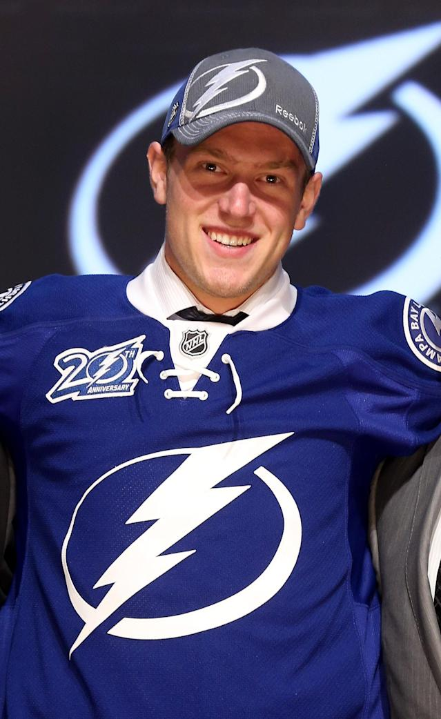 PITTSBURGH, PA - JUNE 22: Slater Koekkoek, tenth overall pick by the Tampa Bay Lightning, poses on stage during Round One of the 2012 NHL Entry Draft at Consol Energy Center on June 22, 2012 in Pittsburgh, Pennsylvania. (Photo by Bruce Bennett/Getty Images)
