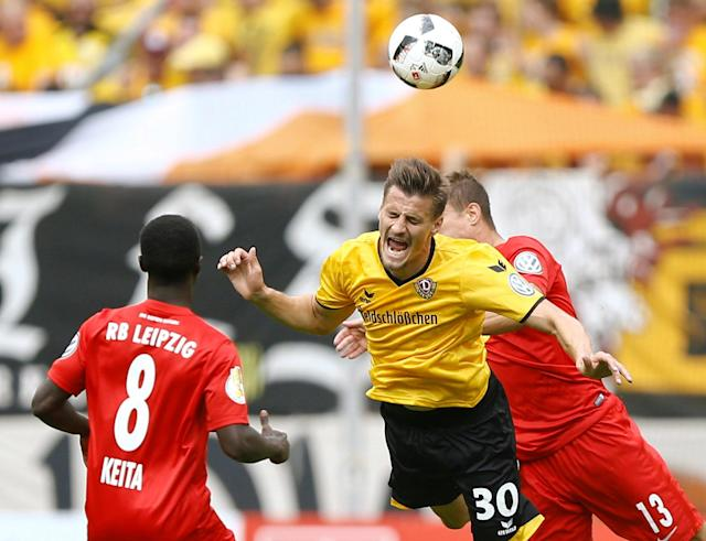 Football Soccer - Dynamo Dresden v RB Leipzig - German Cup (DFB Pokal) - DDV-Stadion, Dresden, Germany - 20/08/16. Dynamo Dresden's Stefan Kutschke in action with RB Leipzig's Naby Deco Keita (L) and Stefan Ilsanker (R). REUTERS/Axel Schmidt DFB RULES PROHIBIT USE IN MMS SERVICES VIA HANDHELD DEVICES UNTIL TWO HOURS AFTER A MATCH AND ANY USAGE ON INTERNET OR ONLINE MEDIA SIMULATING VIDEO FOOTAGE DURING THE MATCH.