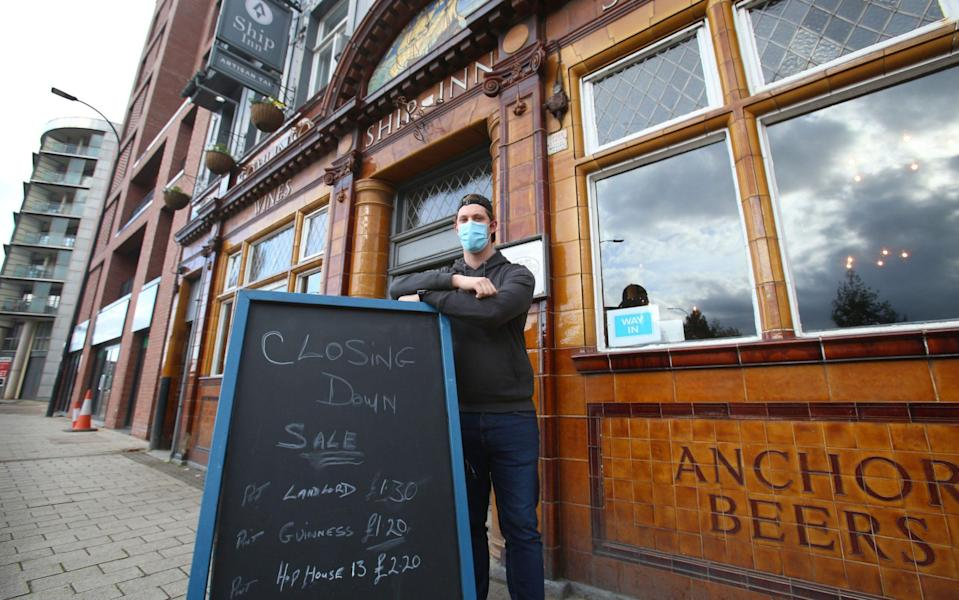 Connor Recknell, pictured with the 'closing down' sign at the Ship Inn, says: 'People have lost jobs, and that will be the case right across Kelham Island' - Lorne Campbell/Guzelian
