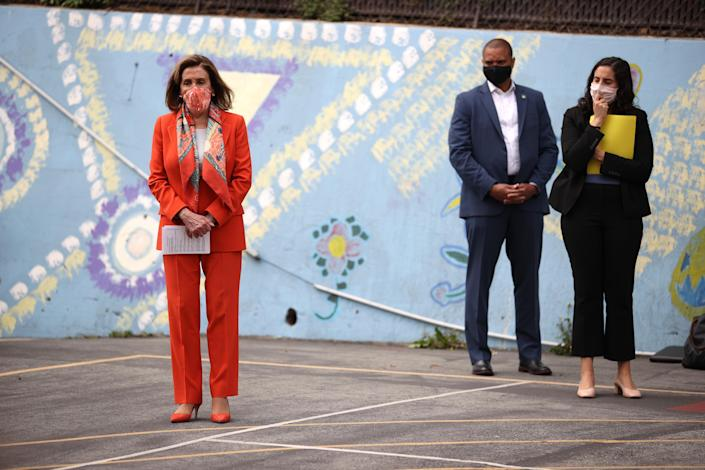 SAN FRANCISCO, CALIFORNIA - SEPTEMBER 02: U.S. Speaker of the House Nancy Pelosi (L) (D-CA) looks on during a Day of Action For the Children event at Mission Education Center Elementary School on September 02, 2020 in San Francisco, California. Nancy Pelosi is drawing criticism for patronizing a hair salon to get her hair done despite the salon being closed to in-person visits due to COVID-19 restrictions. (Photo by Justin Sullivan/Getty Images)