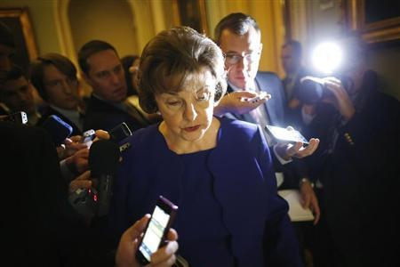 U.S. Senator Feinstein is trailed by reporters as she walks to the weekly Democratic caucus policy luncheon at the U.S. Capitol in Washington