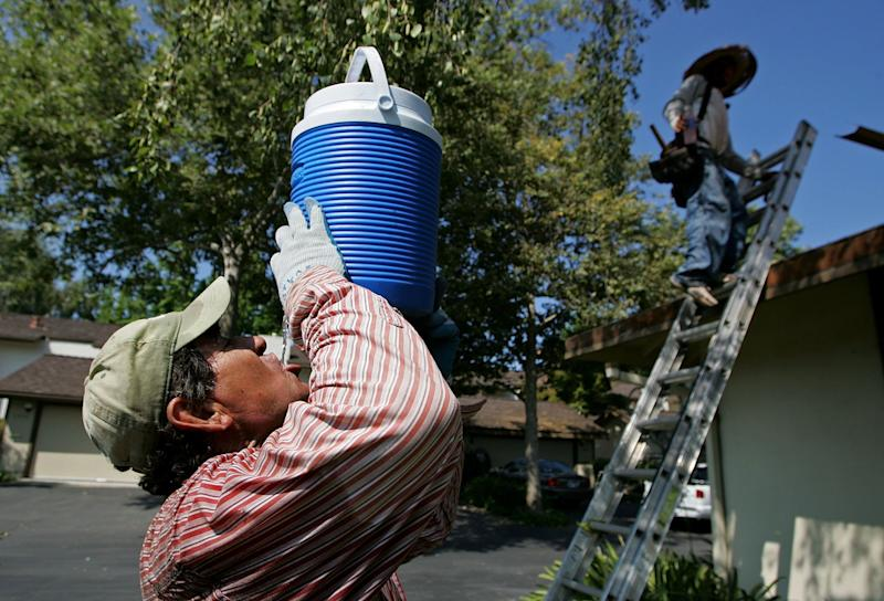 Extreme heat can take a severe, even deadly, toll on those who work outdoors. (Photo: Justin Sullivan via Getty Images)