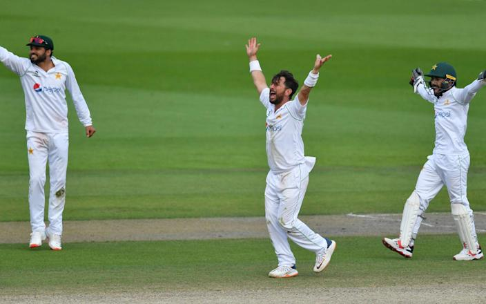 Pakistan's Yasir Shah, center, captain Azhar Ali, left, and Mohammad Rizwan appeal unsuccessfully for the wicket of England's Jos Buttler - Getty Pool