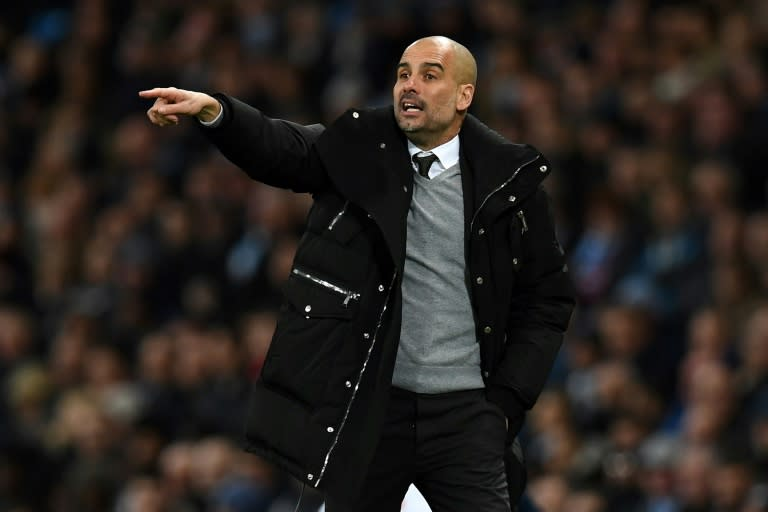 Manchester City's manager Pep Guardiola gestures on the touchline during the English Premier League football match between Manchester City and Stoke City at the Etihad Stadium in Manchester, north west England, on March 8, 2017