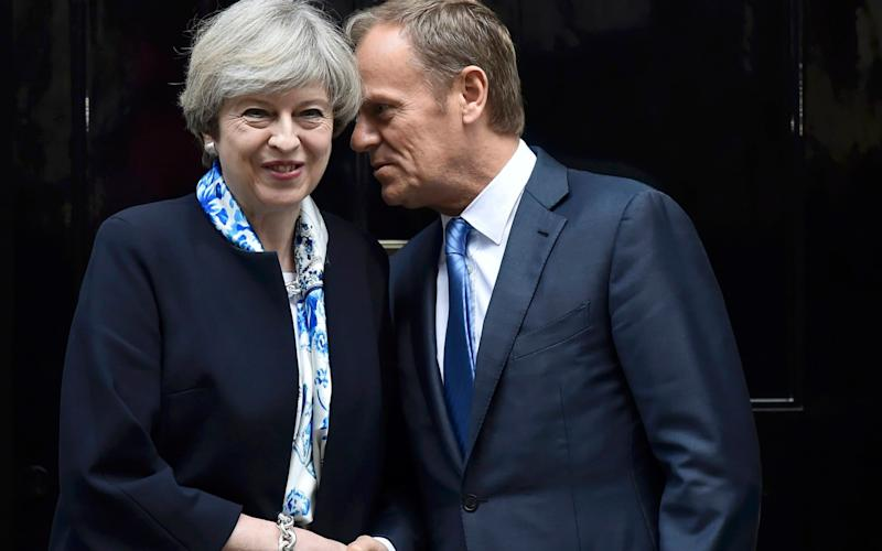 May and Tusk - Credit: Reuters