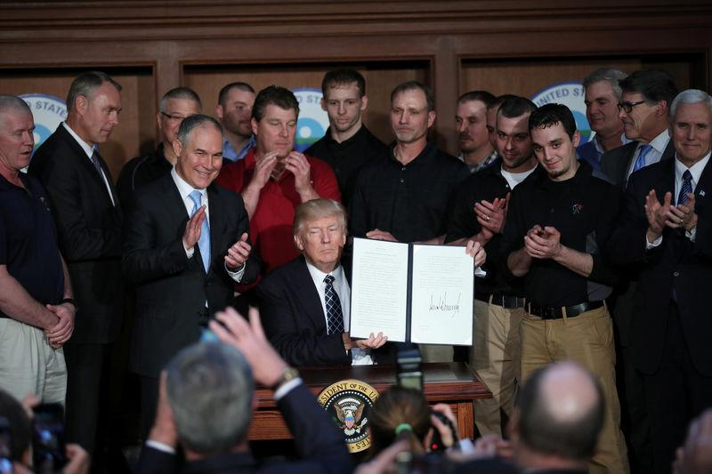 """U.S. President Trump displays executive order on """"energy independence"""" during event at EPA headquarters in Washington"""