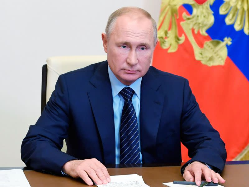 Russia's President Putin takes part in a a video conference call outside Moscow