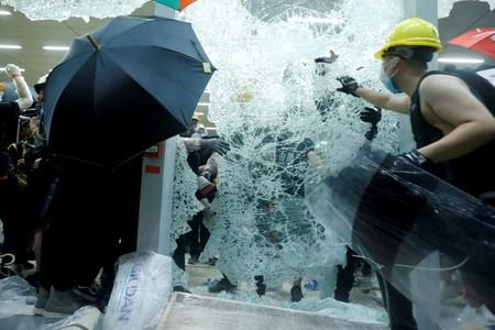 FILE PHOTO: Protesters break the windows of the Legislative Council building on the anniversary of Hong Kong's handover to China in Hong Kong