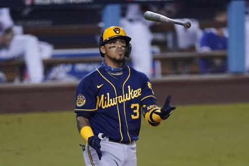 Milwaukee Brewers' Orlando Arcia flips his bat after striking out during the fourth inning in Game 2 of the team's National League wild-card baseball series against the Los Angeles Dodgers on Thursday, Oct. 1, 2020, in Los Angeles. (AP Photo/Ashley Landis)
