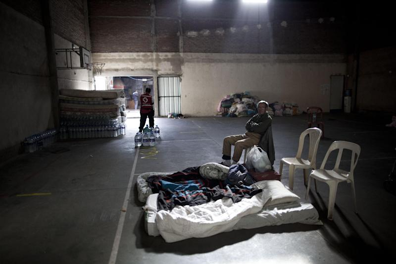 Juan Fernandez sits inside a club where the Red Cross set up a help center for people affected by flooding after his home was damaged in La Plata, in Argentina's Buenos Aires province, Thursday, April 4, 2013. Buenos Aires Gov. Daniel Scioli says 49 people died in this flooded capital of Argentina's largest province as torrential rains swamped entire neighborhoods, washing away cars and flooding some houses to their rooftops. The overall death toll is now 55, and more than 20 people are missing. (AP Photo/Natacha Pisarenko)