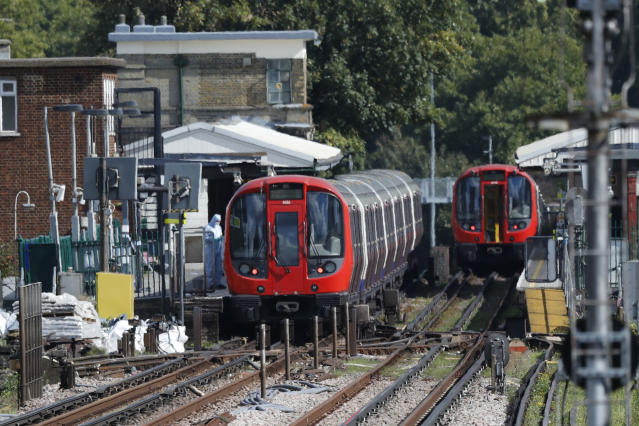 <p>A police forensic officer stands beside the train, at left, where an incident happened, that police say they are investigating as a terrorist attack, at Parsons Green subway station in London, Friday, Sept. 15, 2017. (Photo: Frank Augstein/AP) </p>