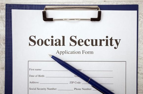 Top half of form on clipboard that says social security application form