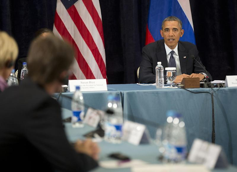 "President Barack Obama participates in a ""Civil Society Roundtable,"" Friday, Sept. 6,2013, in St. Petersburg, Russia. At left is Igor Kochetkov chairman of the Russian LGBT Network. (AP Photo/Pablo Martinez Monsivais)"