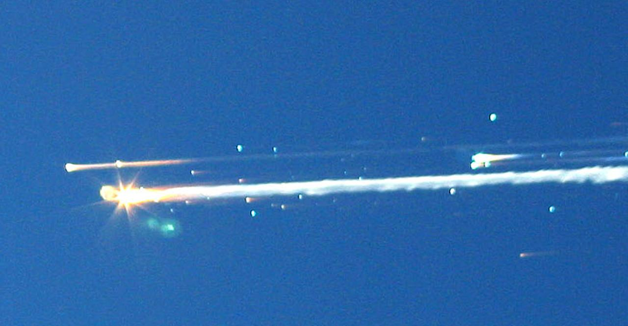 "FILE - In this Feb. 1, 2003 file photo, debris from the space shuttle Columbia streaks across the sky over Tyler, Texas. The Columbia broke apart in flames 200,000 feet over Texas on Saturday, killing all seven astronauts just minutes before they were to glide to a landing in Florida. Ten years later, reminders of Columbia are everywhere, including up in the sky. Everything from asteroids, lunar craters and Martian hills, to schools, parks, streets and even an airport (Rick Husband Amarillo International Airport) bear the Columbia astronauts' names. Two years ago, a museum opened in Hemphill, Texas, where much of the Columbia wreckage rained down, dedicated to ""remembering Columbia."" About 84,000 pounds of that wreckage, representing 40 percent of NASA's oldest space shuttle, are stored at Kennedy and loaned for engineering research. (AP Photo/Scott Lieberman) MANDATORY CREDIT"