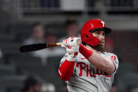 Philadelphia Phillies right fielder Bryce Harper (3) follows through on a double in the eighth inning of a baseball game against the Atlanta Braves, Friday, May 7, 2021, in Atlanta. (AP Photo/John Bazemore)