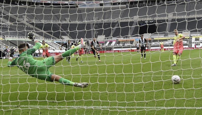 Manchester City's Kevin De Bruyne scores the opening goal from the penalty spot during the FA Cup sixth round soccer match between Newcastle United and Manchester City at St. James' Park in Newcastle, England, Sunday, June 28, 2020. (Shaun Botterill/Pool via AP)
