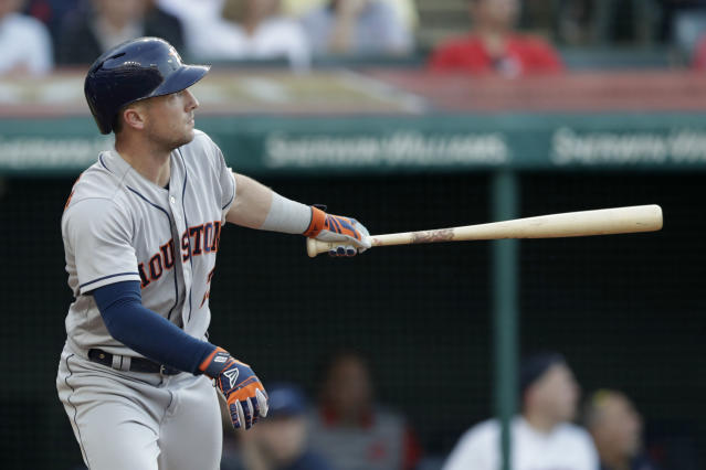 Houston Astros' Alex Bregman watches his ball after hitting a three-run home run off Cleveland Indians starting pitcher Mike Clevinger in the fifth inning of a baseball game, Thursday, May 24, 2018, in Cleveland. Tony Kemp and George Springer scored on the play. (AP Photo/Tony Dejak)