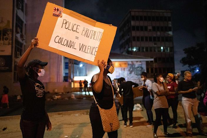 """""""Police Brutality = Colonial Violence"""", read another sign"""