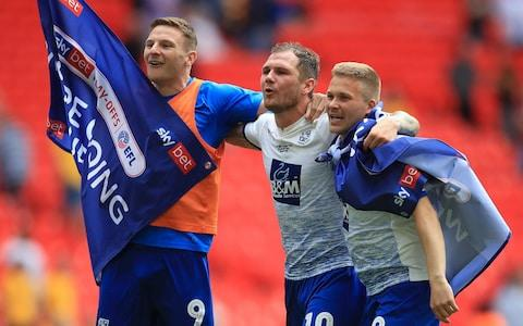 Tranmere Rovers' Paul Mullin James Norwood (centre) and Jay Harris celebrate promotion - Credit: PA