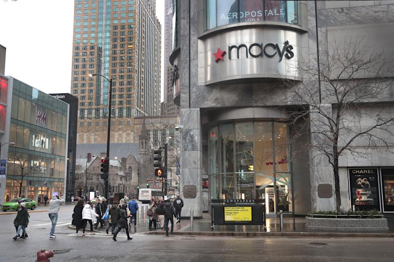 CHICAGO, ILLINOIS - NOVEMBER 21: Pedestrians walk past a Macy's store downtown on November 21, 2019 in Chicago, Illinois. Macy's Inc. reported a drop in third quarter sales and said the company is anticipating a weak holiday quarter as they, like other department stores, struggle to continue to attract customers. (Photo by Scott Olson/Getty Images)