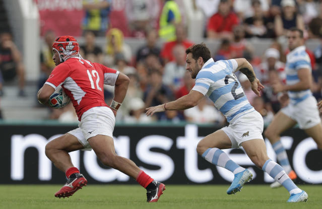 Tonga's Siale Piutau runs with the ball during their match against Argentina at the Rugby World Cup Pool C game at Hanazono Rugby Stadium in Osaka, Japan, Saturday, Sept. 28, 2019. (AP Photo/Aaron Favila)