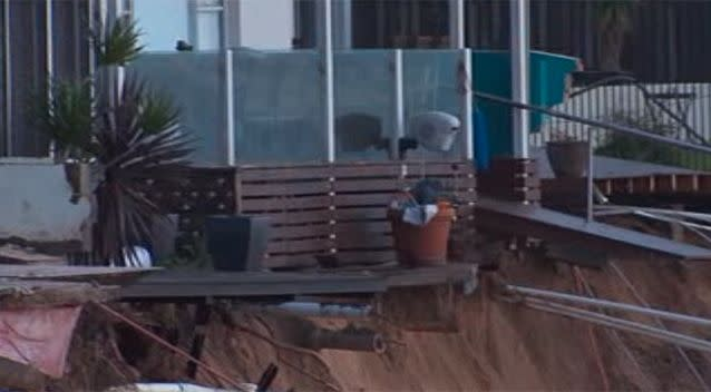 The erosion stopped right before the foundation of the housing, however residents will be bracing themselves for high tide on Monday night. Photo: 7 News