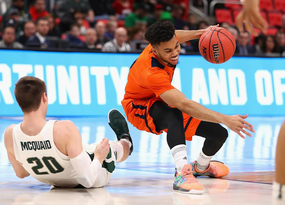 Stephen Brown rocked some bright coral basketball shoes against Michigan State on Friday because his team shoes fell apart. (Getty Images)