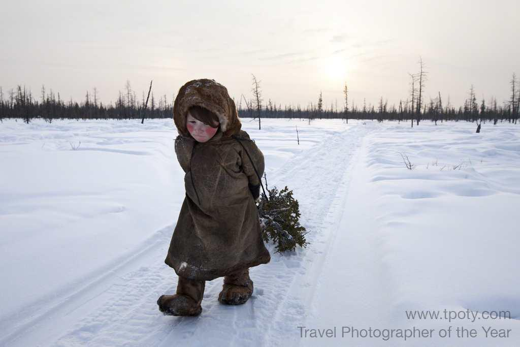 Siberia, Russia. Yamalo Nemets' winter camp in the tundra. This young girl collects wood in the forest. <br><br>Alessandra Meniconzi, Switzerland<br><br>Camera: Canon EOS 1DS Mk3	<br><br>Winner, New Talent award  For her success in the New Talent category 'Another World', <br><br>Alessandra Meniconzi (Switzerland) – a graphic designer, teacher and semi-professional photographer, who is hoping to become a full-time photographer - wins a trip to the Gnaoua and World Music Festival in Essaouira, Morocco with sustainable travel specialists Tribes Travel, a Fujifilm FinePix X100 camera, Plastic Sandwich leather portfolio book or iFolio, plus a Digimarc for Images Professional Edition subscription and Adobe Photoshop CS6 software.
