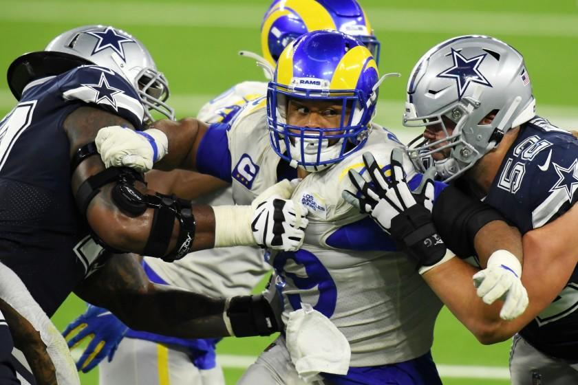 INGLEWOOD, CALIFORNIA - SEPTEMBER 13: Aaron Donald #99 of the Los Angeles Rams rushes against Connor Williams #52 and the Dallas Cowboys offensive line during the second half at SoFi Stadium on September 13, 2020 in Inglewood, California. (Photo by Harry How/Getty Images)