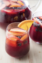 """<p>A big batch of sangria makes everyone light and bubbly.</p><p>Get the recipe from <a href=""""https://www.delish.com/cooking/recipe-ideas/a19601715/easy-red-sangria-recipe/"""" rel=""""nofollow noopener"""" target=""""_blank"""" data-ylk=""""slk:Delish"""" class=""""link rapid-noclick-resp"""">Delish</a>.</p>"""