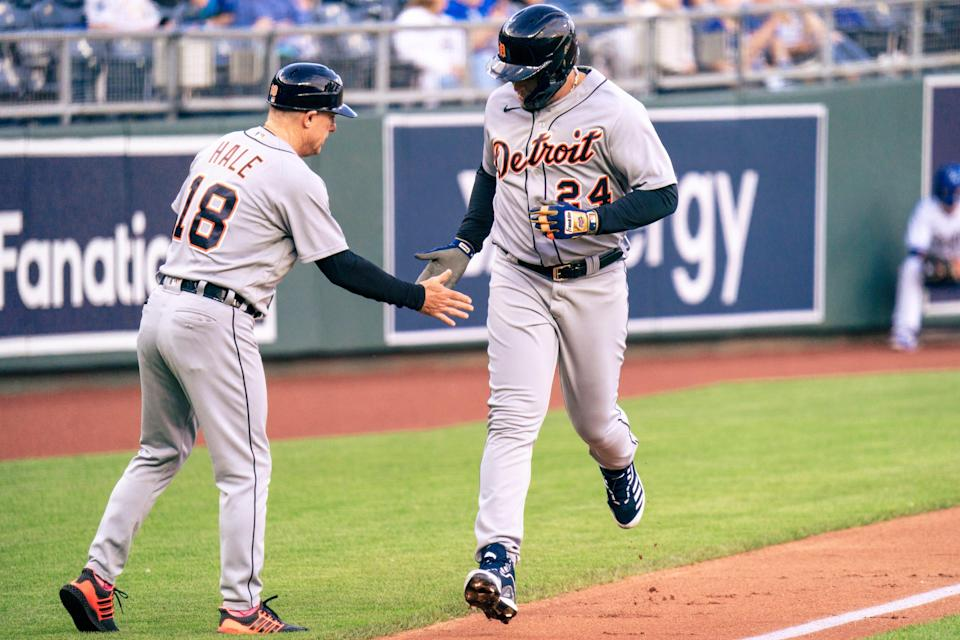 Miguel Cabrera of the Detroit Tigers rounds third and celebrates with Chip Hale after hitting a solo home run against the Kansas City Royals in the second inning at Kauffman Stadium in Kansas City, Missouri, on May 21, 2021.