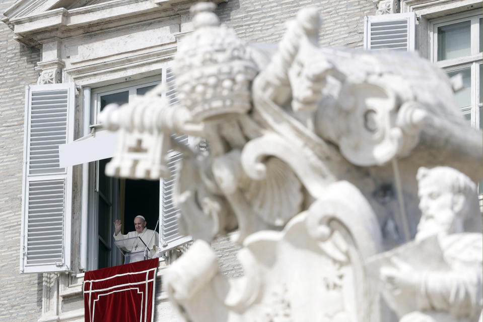 Pope Francis waves during the Angelus noon prayer delivered from his studio window overlooking St. Peter's Square, at the Vatican, Sunday, Oct. 4, 2020. (AP Photo/Gregorio Borgia)