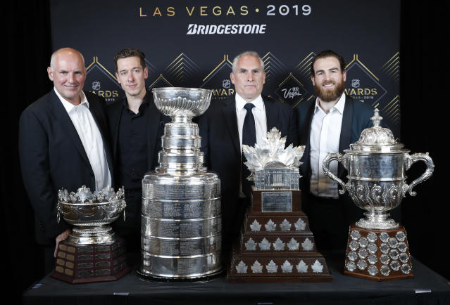 From left, St. Louis Blues general manager Doug Armstrong, goalie Jordan Binnington, interim coach Craig Berube and center Ryan O'Reilly pose at the NHL Awards, Wednesday, June 19, 2019, in Las Vegas. (AP Photo/John Locher)