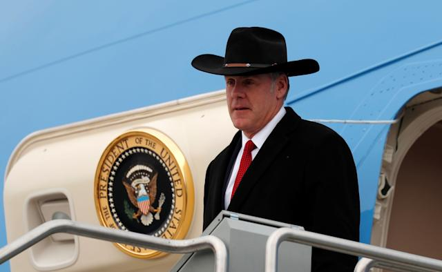Interior Secretary Ryan Zinke steps from Air Force One as President Donald Trump arrives in Salt Lake City, Utah, on Dec. 4, 2017.