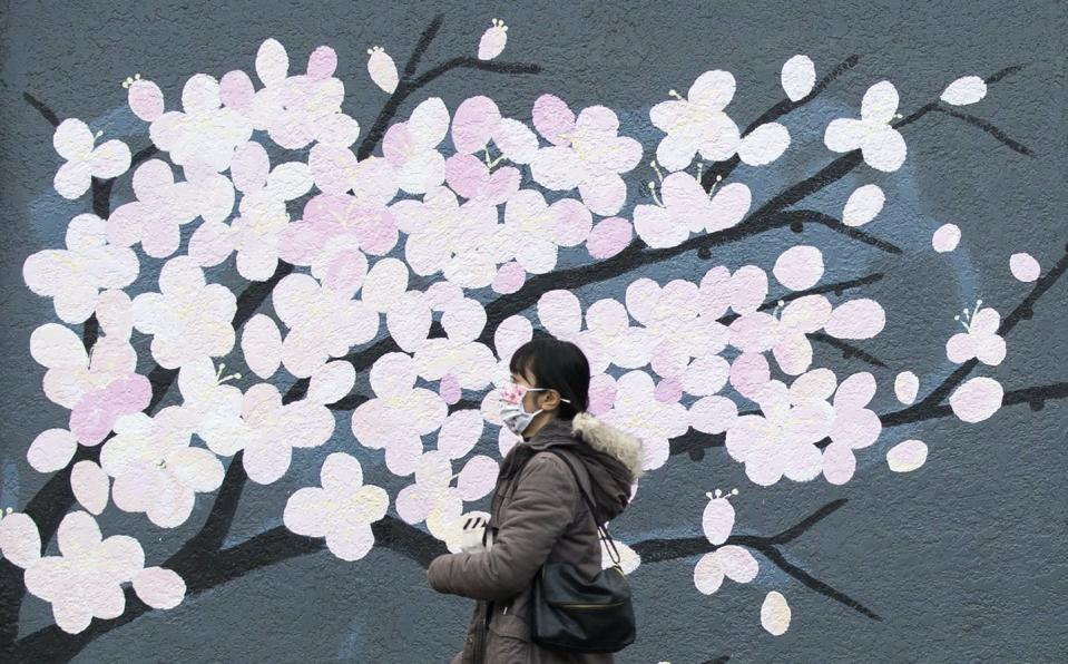 """<span class=""""caption"""">A woman walks past a mural in Vancouver, B.C. The power of public art is its ability to turn artistic practice into a social action.</span> <span class=""""attribution""""><span class=""""source"""">THE CANADIAN PRESS/Marissa Tiel </span></span>"""