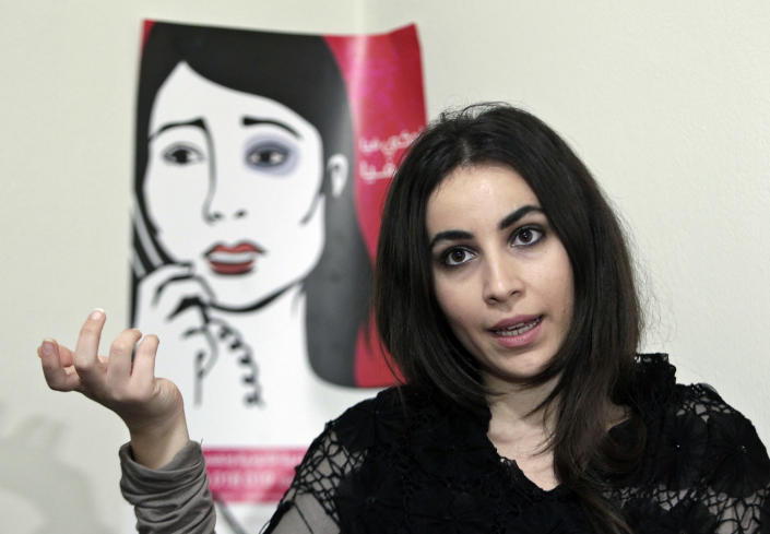 """In this Wednesday, Feb. 26, 2014 photo, Maya al-Ammar, an official with the Lebanese women's rights group Kafa, Arabic for """"Enough,"""" speaks during an interview with The Associated Press in her office, in Beirut, Lebanon. Although Lebanon appears very progressive on women rights compared to other countries in the Middle East, domestic violence remains an unspoken problem and the nation's parliament has yet to vote on a bill protecting women's rights nearly three years after it was approved by the Cabinet. On Saturday, March 8, 2014 about 5,000 people marched in Beirut to demand protection for women and urged the parliament to vote on the domestic violence law. (AP Photo/Bilal Hussein)"""