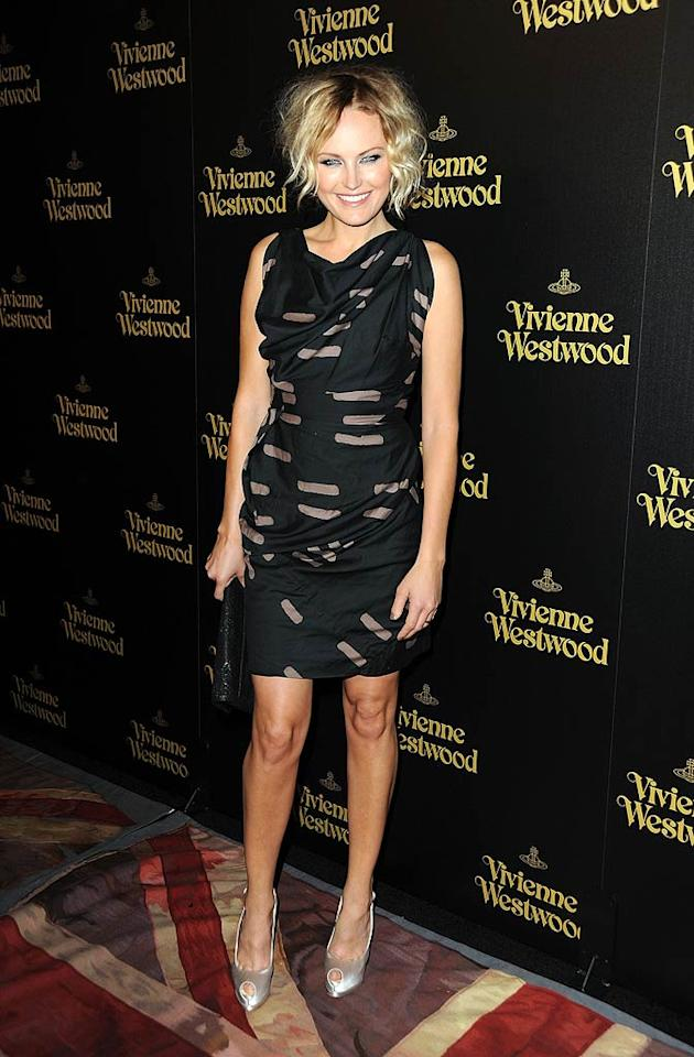 """The Proposal's"" Malin Akerman was also in attendance at the Vivienne Westwood launch. The 32-year-old actress showed off her flawless face thanks to a sassy new 'do and her stems thanks to a Vivienne-designed Anglomania Pre-Fall 2011 printed dress and silver satin peep-toes. Frazer Harrison/<a href=""http://www.gettyimages.com/"" target=""new"">GettyImages.com</a> - March 30, 2011"