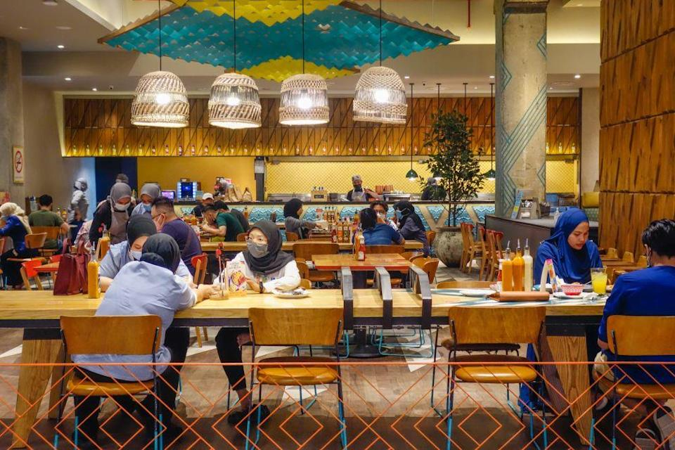Patrons dine-in at a restaurant in Kuala Lumpur during Phase Two of the National Recovery Plan on September 10, 2021. — Picture by Shafwan Zaidon